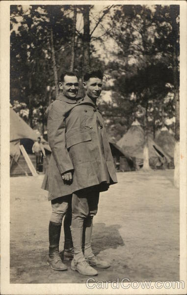 Two Men Sharing a Coat People in Uniform