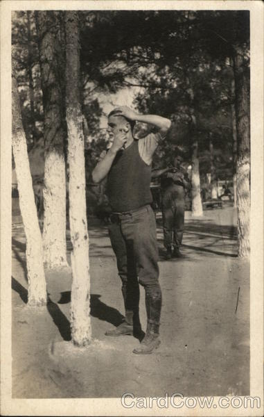 Soldier Shaving in Front of a Tree People in Uniform