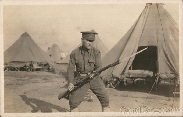 Soldier Posing With Rifle in Camp People in Uniform
