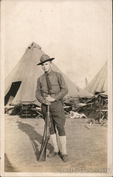 Soldier with Rifle Posing in Camp People in Uniform