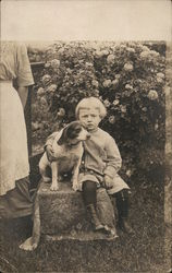 Boy Posing with His Dog in the Garden