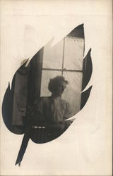 Woman Posing in Front of a Window Leaf Vignette