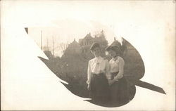Snapshot of Two Women In Front of Residences Leaf Vignette
