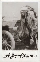 Indian Chief Posing in Front of a Car