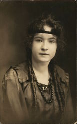 Woman with headband, beads