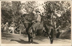 Soldier in Camp Posing on a Horse