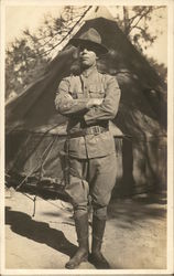 Soldier Posing in Front of Tent