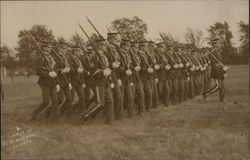 Soldiers Marching in Formation with Rifles