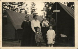 Soldier Posing with Family in front of Tents