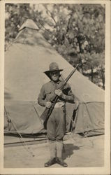 Soldier with Rifle Posing in Camp