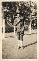 Soldier with Pistol Posing in Camp