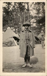 Soldier in an Overcoat Posing in Camp