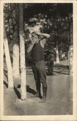 Soldier Shaving in Front of a Tree