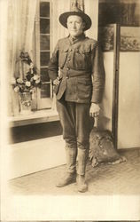 Soldier Posing in Front of a Window