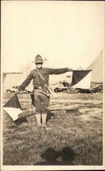 Soldier Demonstrating Semaphore in Camp