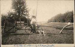Woman Posing With a Bicycle and Dog