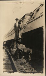 Women exiting a train that has derailed - early 1900's