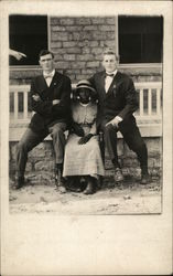 Two Men with Black Woman