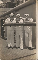 Three Sailors on Deck