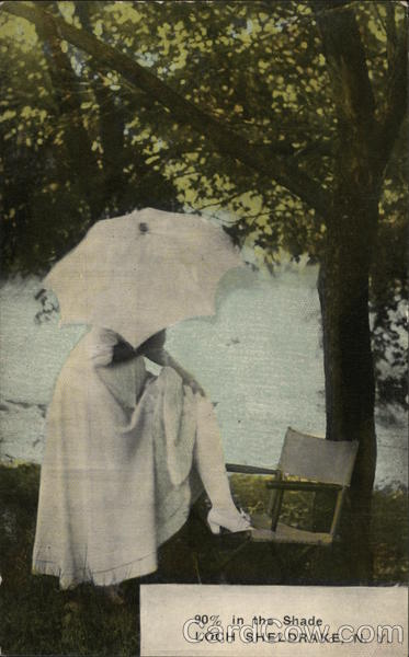 90% in the shade - woman with parasol under a tree Loch Sheldrake New York