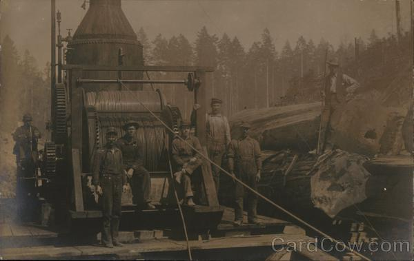 Seven Loggers with Machinery & Cut Timber, Trees in Background Eureka California