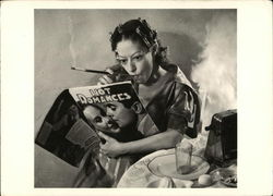"Woman in Curlers reading ""Hot Romances"" Magazine - Untitled, 1942"