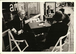 Andy Warhol Seated at Table