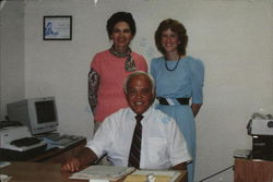 William W. Scott, Agent - With Two Women Standing