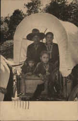 A Navaho Family in covered wagon
