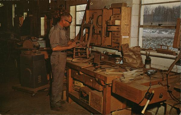An Amana Craftsman Works on a Walnut Rocking Chair