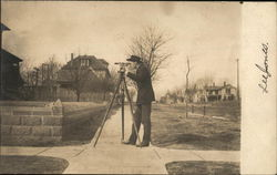 Surveyor Using Transom on Street