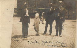 "71 lbs - 4' 9"" long Fulton Cat displayed by three men - caught by Ned. 7/22/1908"