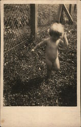 Nude Child Running in Grass