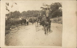 Group of People Following Carriage Pulled by Horse