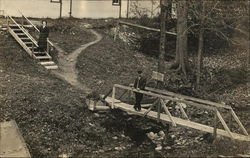 Couple Crossing Creek Bridge