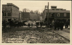 Muddy Street After Flood With People Viewing Damage