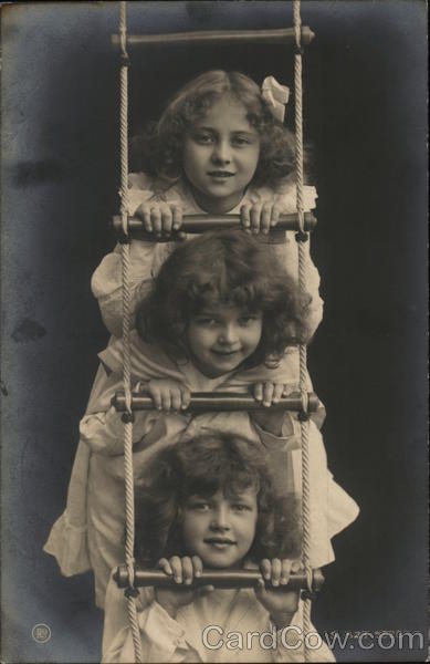 Portrait of Three Girls on Rope Ladder