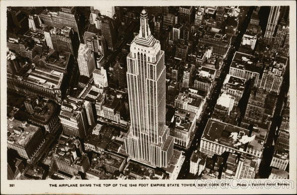 The Airplane Skims the Top of the Empire State Tower New York City
