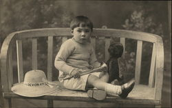 Boy Posing With Horn and Stuffed Bear