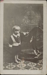 Boy Posing With Rocking Horse