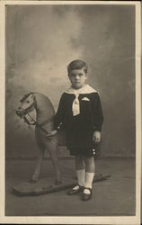 Portrait of Boy With Toy Horse