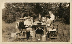 Outdoor Meal - People at Picnic Table