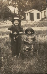 Two Children and Puppy in Field