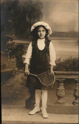 Girl Posing With Tennis or Badminton Raquet
