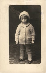 Young Child in Sweater and Knit Cap