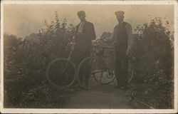 Two Men and Their Bikes Postcard