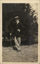 Snapshot of Man With Cane