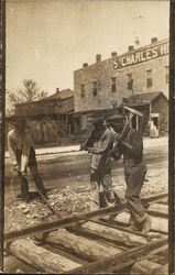 3 Railroad Workers on Tracks St. Charles Hotel
