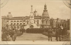 Gathering of People In Front of Ornate Building