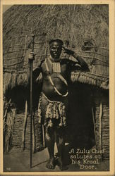 A Zulu chief salutes at his Kraal Door